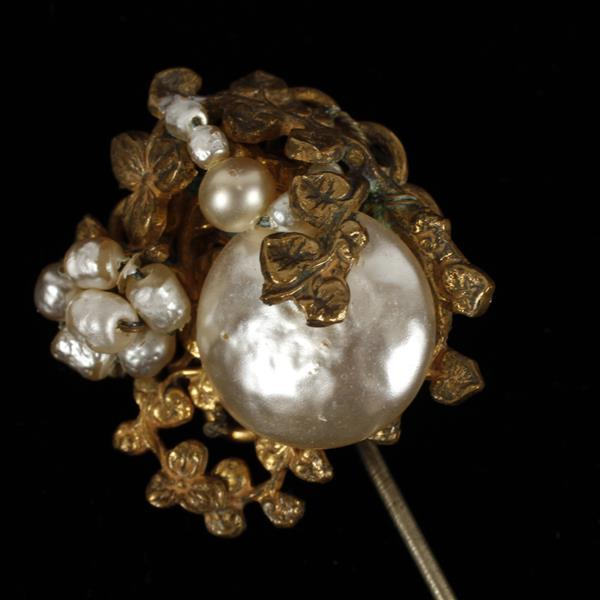 Miriam Haskell baroque pearl and brass filigree stick pin.