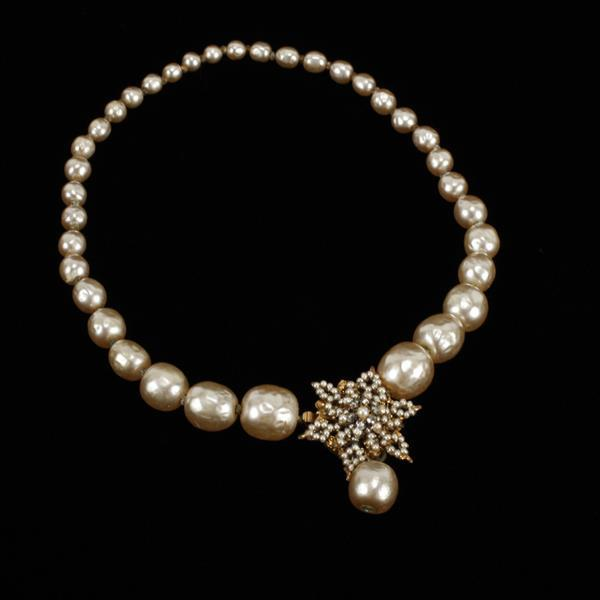 Miriam Haskell faux champagne pearl necklace with seed pearl filigree star flower embellishment.