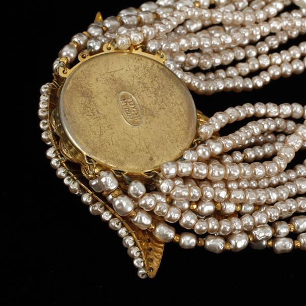 Miriam Haskell multi-strand faux freshwater pearl necklace with gilt beaded leaf embellishment.