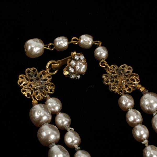 Miriam Haskell gilt filigree rhinestone encrusted faux gray multi pearl floral bib necklace.