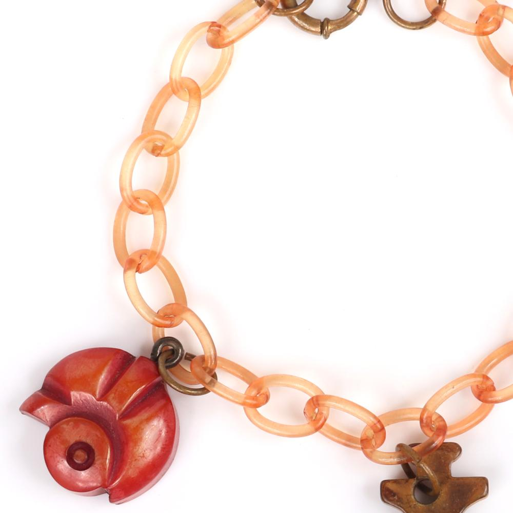 "Vintage Martha Sleeper? Varsity Football and Anchor Bakelite charm bracelet with pink celluloid chain, carved helmet, football and green marble anchor dangles. 7 1/2""L, 1""H (anchor charm)"