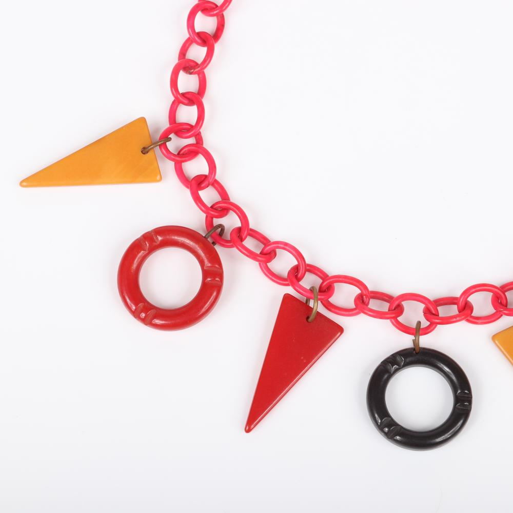 """Vintage Bakelite necklace with red celluloid chain and dangling open circle and triangular geometric charms. 15""""L, 1 3/4""""drop"""