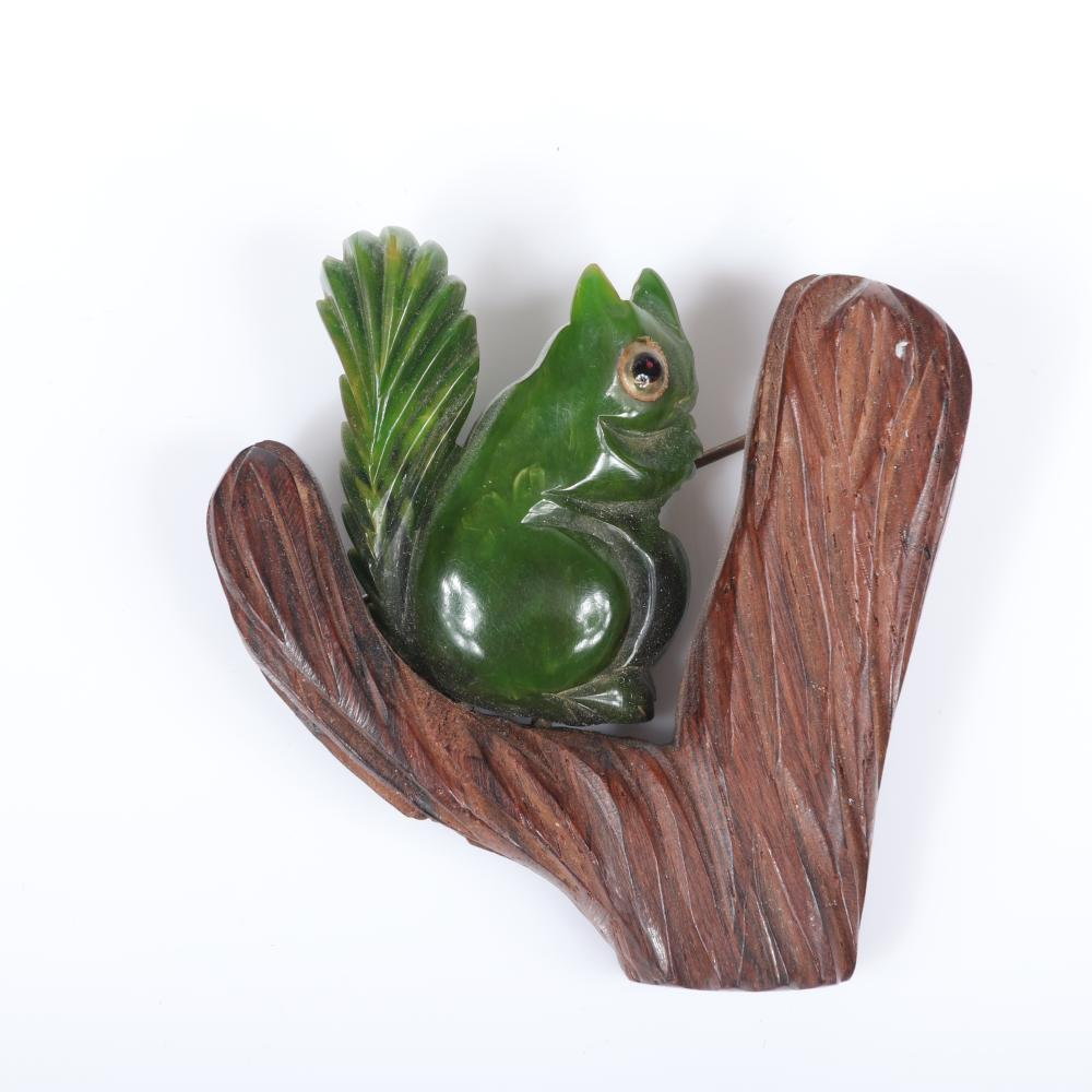 "Two vintage Bakelite woodland animal pins: deeply carved moss woodpecker with glass eye on tree trunk, olive green squirrel with glass eye on tree branch. 2 1/2""H x 1 1/2""W (woodpecker)"