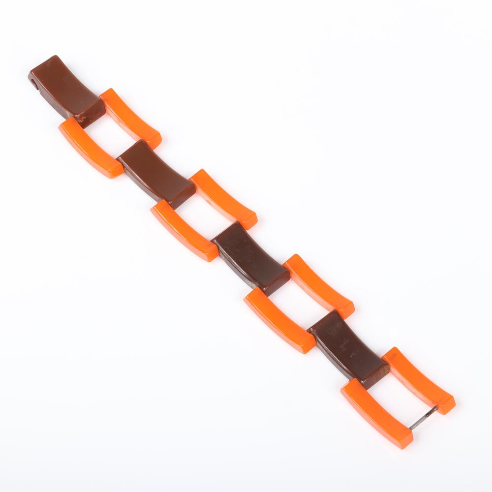 "Vintage Bakelite German / French? art deco machine age bracelet with three rows of alternating tank style curved orange and chocolate brown links. 8""L, 1""W"