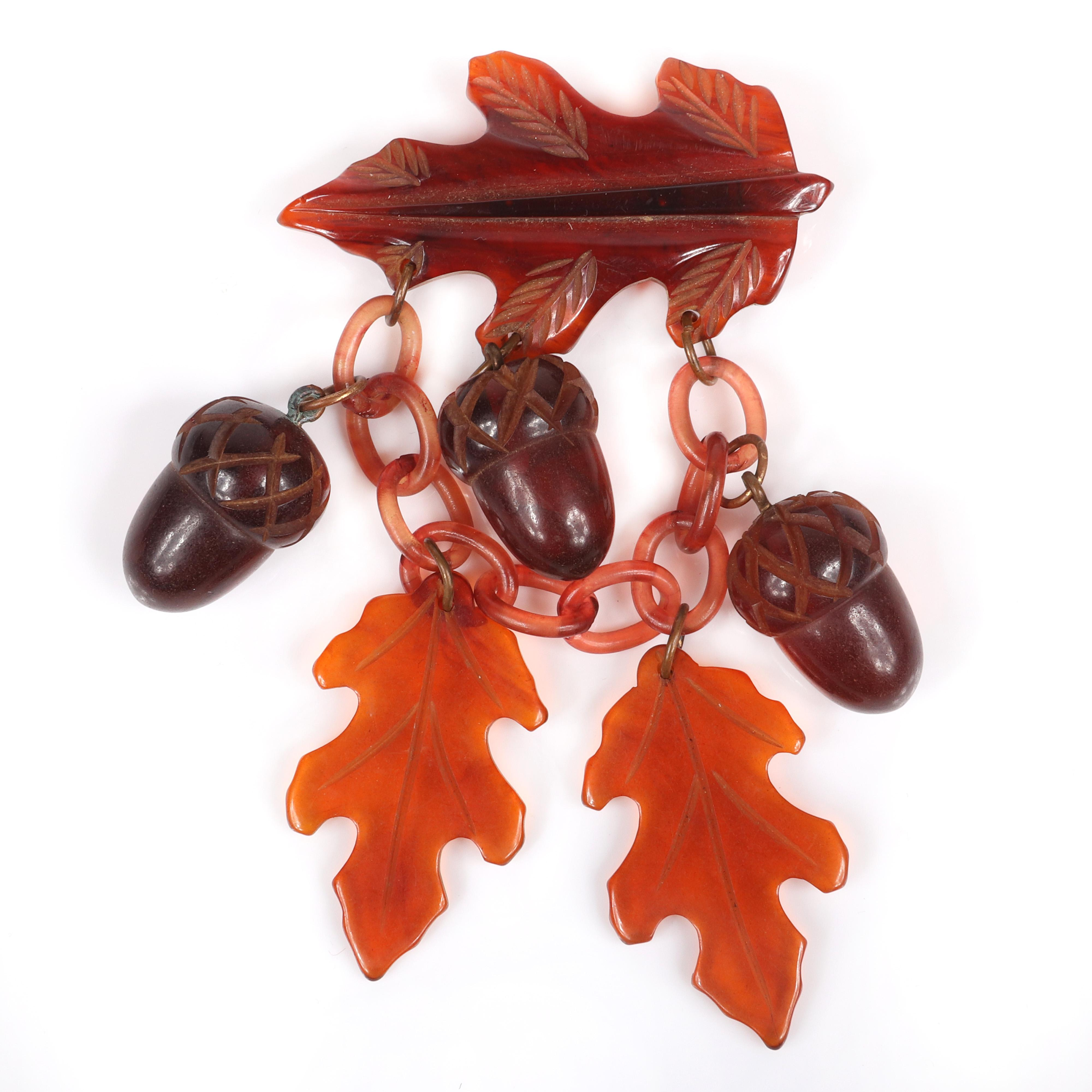 "Bakelite vintage carved Autumn oak leaf pin with amber celluloid chain and carved apple juice oak leaf and coffee bean acorn charms. 4 1/4""H x 2 1/4""W"