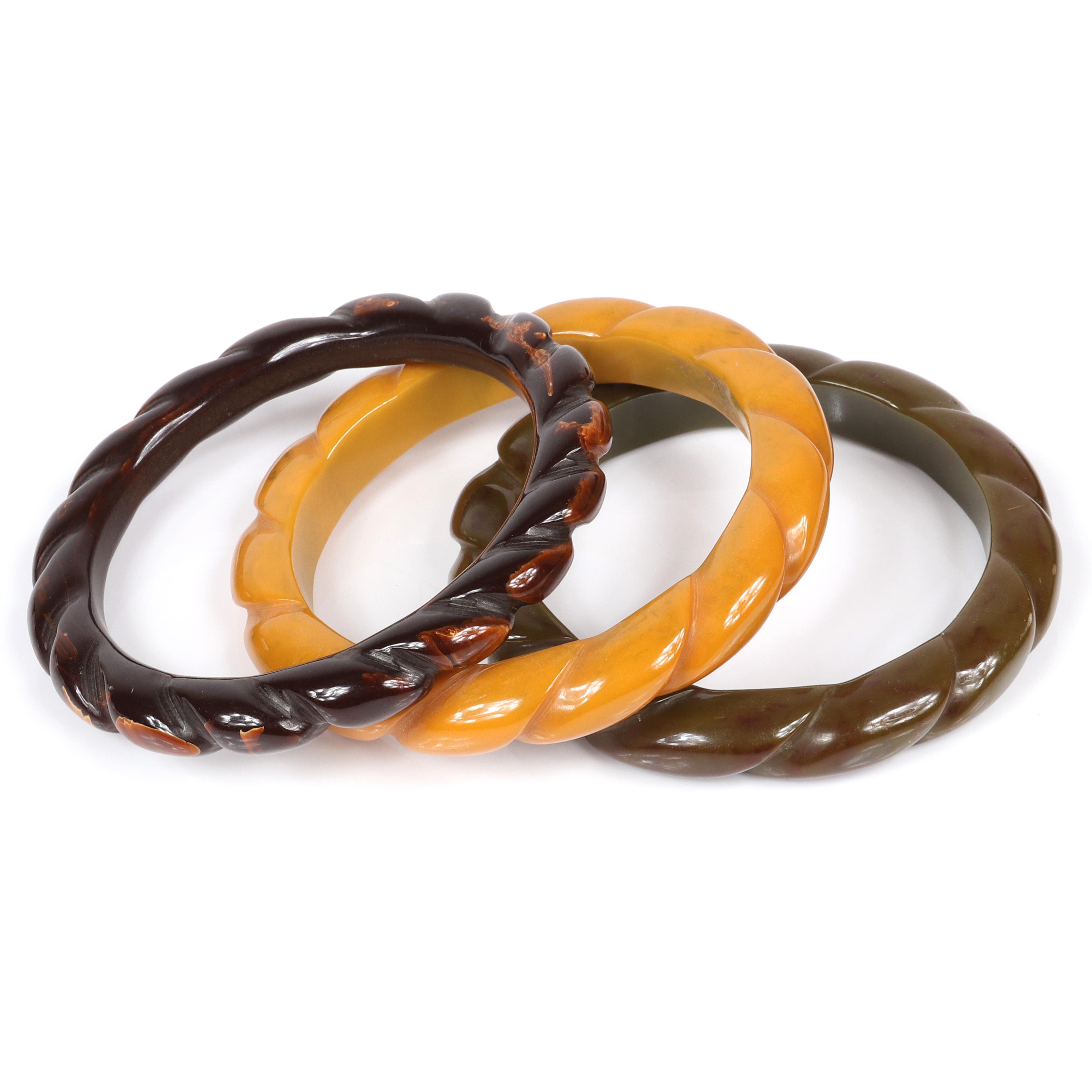 """Three Bakelite bangle bracelets with carved swirl twist design in marbled olive green, brown and butterscotch. 2 1/2"""" inner diam, 3/8""""W (each)"""
