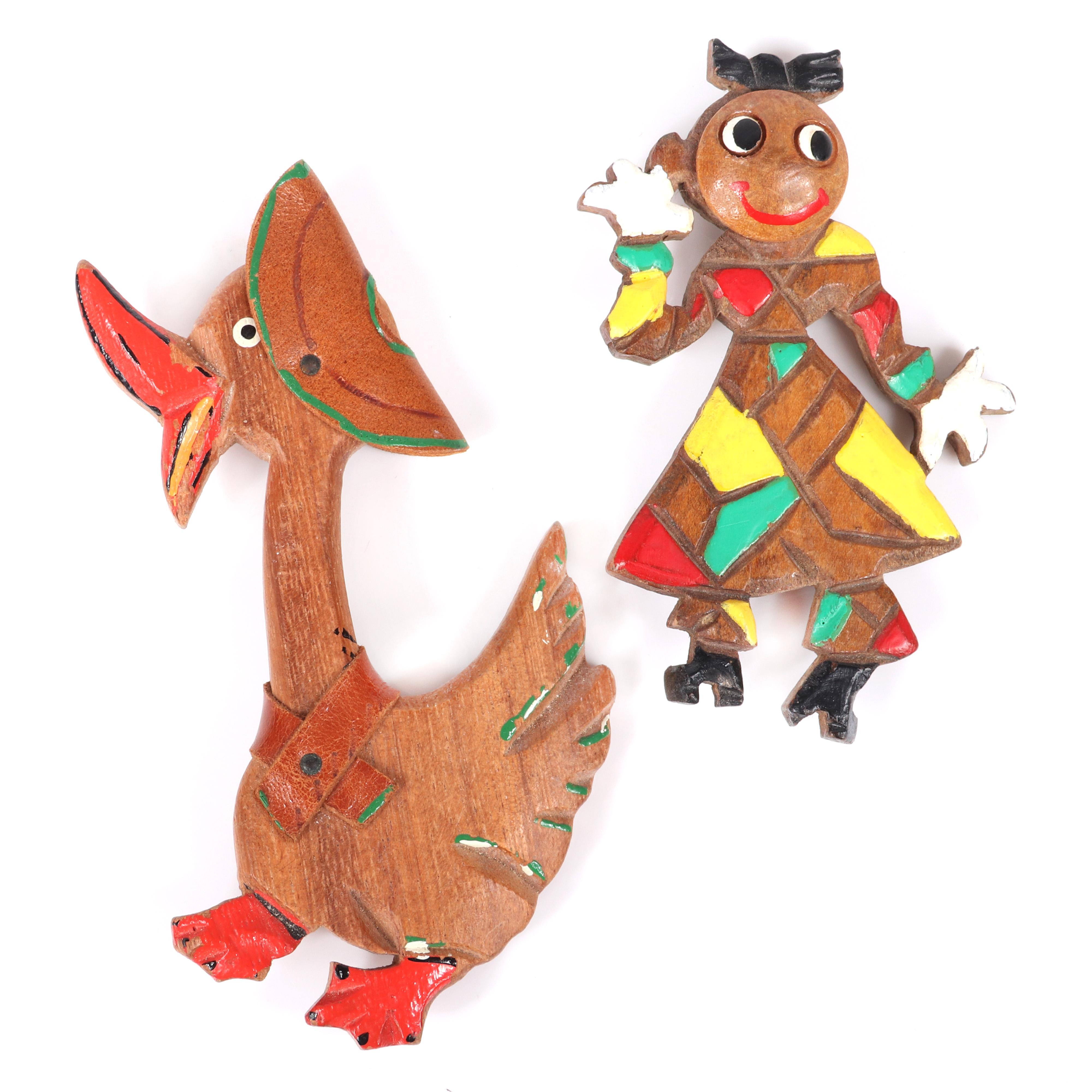 "Two vintage carved and painted wood whimsical brooches: large quacking duck with leather hat and collar and dancing rag doll figural. 4 1/4"" x 3"" (duck)"