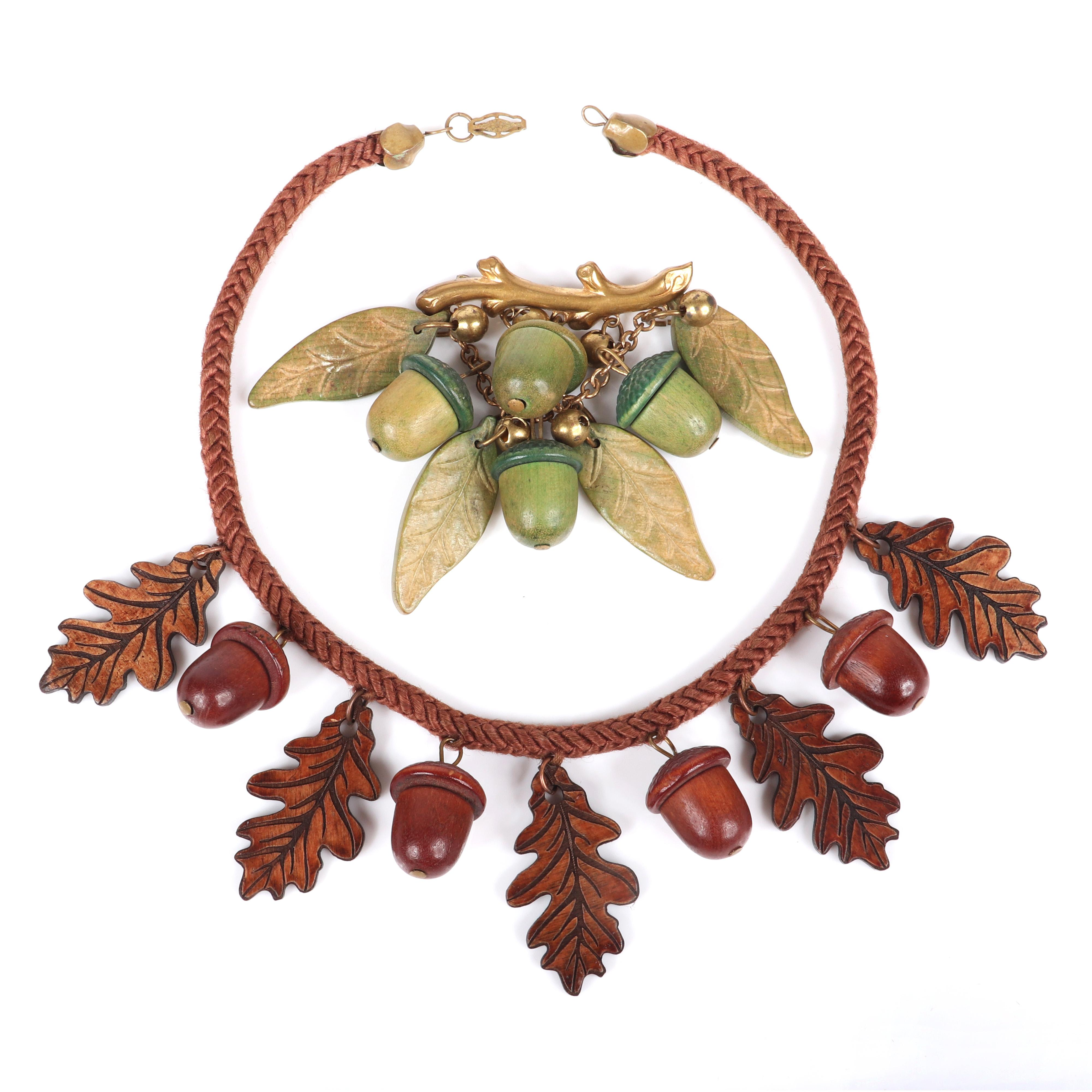 "Vintage carved wood jewelry group: cord necklace with brown stained oak leaf and acorn charms and gold tone pin brooch with metal beads and green stained acorns and leaf dangles. 14 1/2""L (necklace), 3""H x 2 1/2""W..."