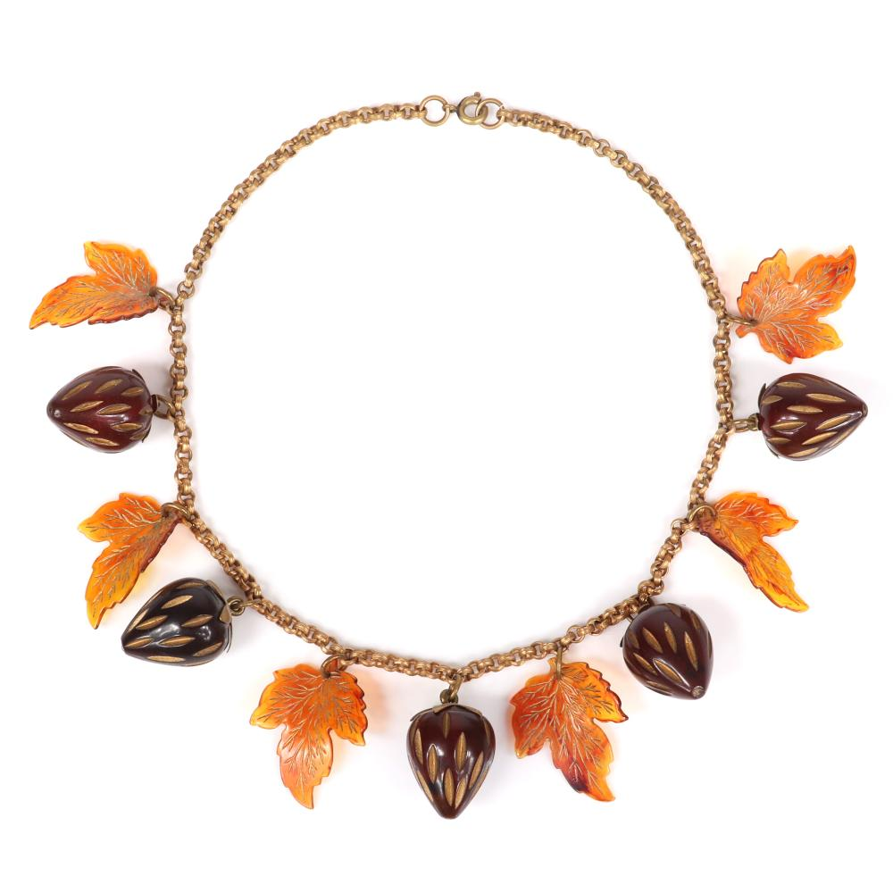 """Vintage Bakelite carved rootbeer strawberry fruit charm necklace on brass chain with metal cap mounts, and celluloid leaf dangles. 15""""L"""