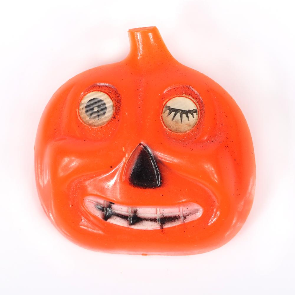 "Vintage celluloid Halloween lenticular winking and smiling jack-o-lantern pumpkin pin brooch with painted features, 1940's/50's. 1 3/4""H x 1 5/8""W"