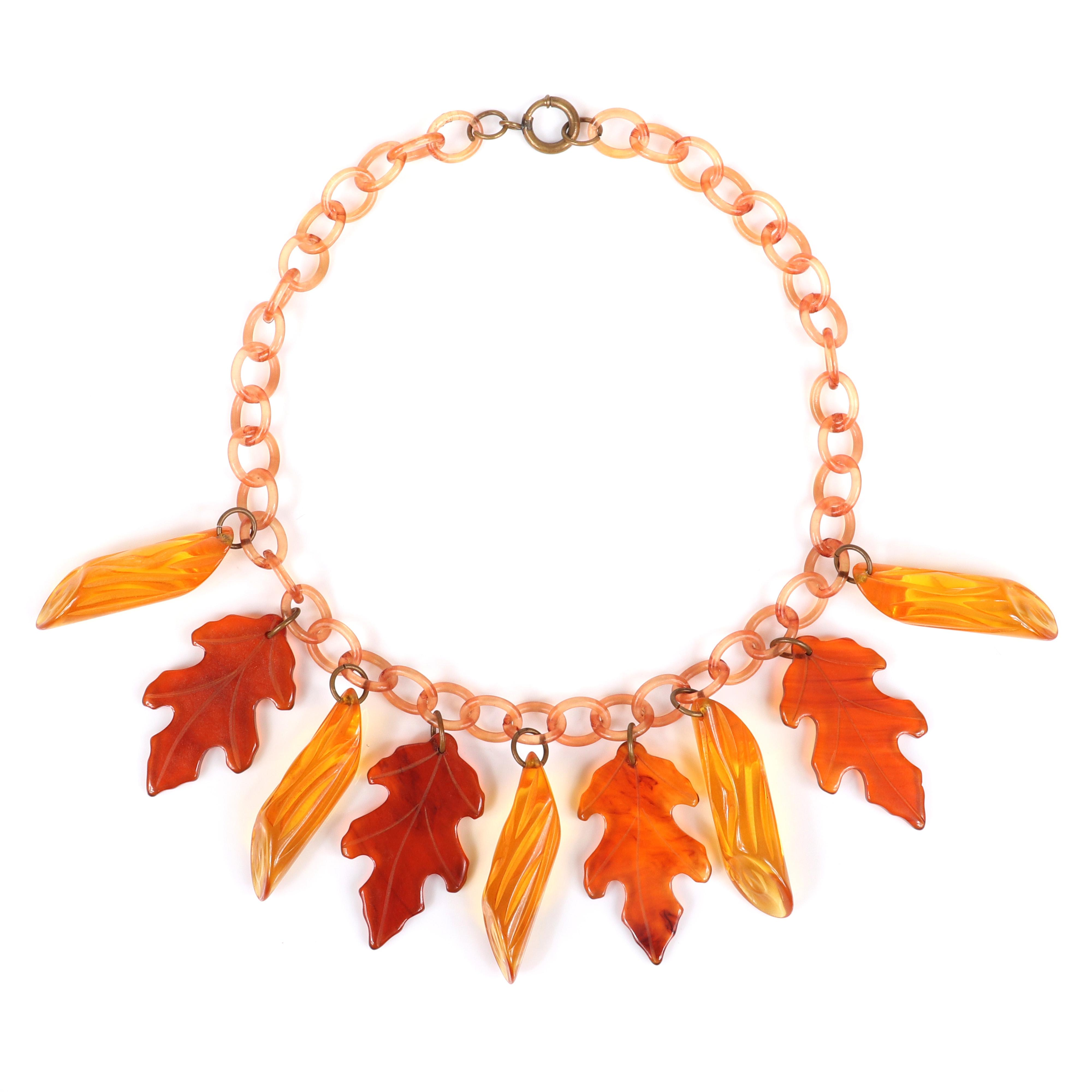"Vintage Bakelite Autumn theme charm necklace with carved apple juice log and oak leaf dangles on celluloid chain. 15""L , 1 3/4""H charm"