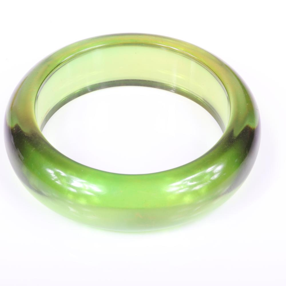 "Vintage transparent Bakelite 4pc group: Two bangle bracelets in green applejuice / Prystal and coordinating reverse painted swirl brooch and pin clip. 2 1/2"" inner diam, 3/4""W (bangles)"