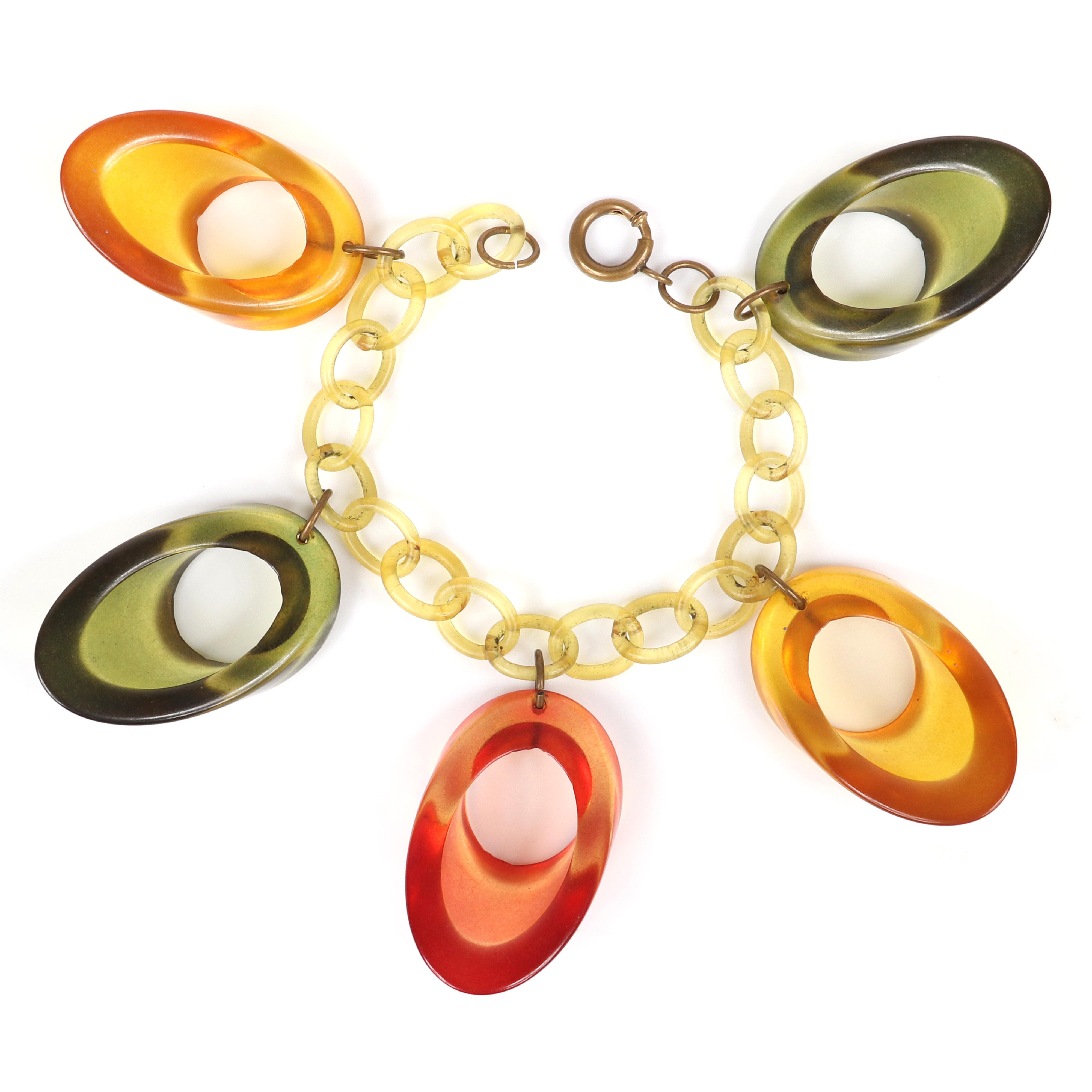 """Vintage Bakelite bracelet with celluloid chain bracelet and five large dangling chunky transparent Prystal circle wedge charms. 7 1/2""""L, 1 1/4""""H (charm)"""