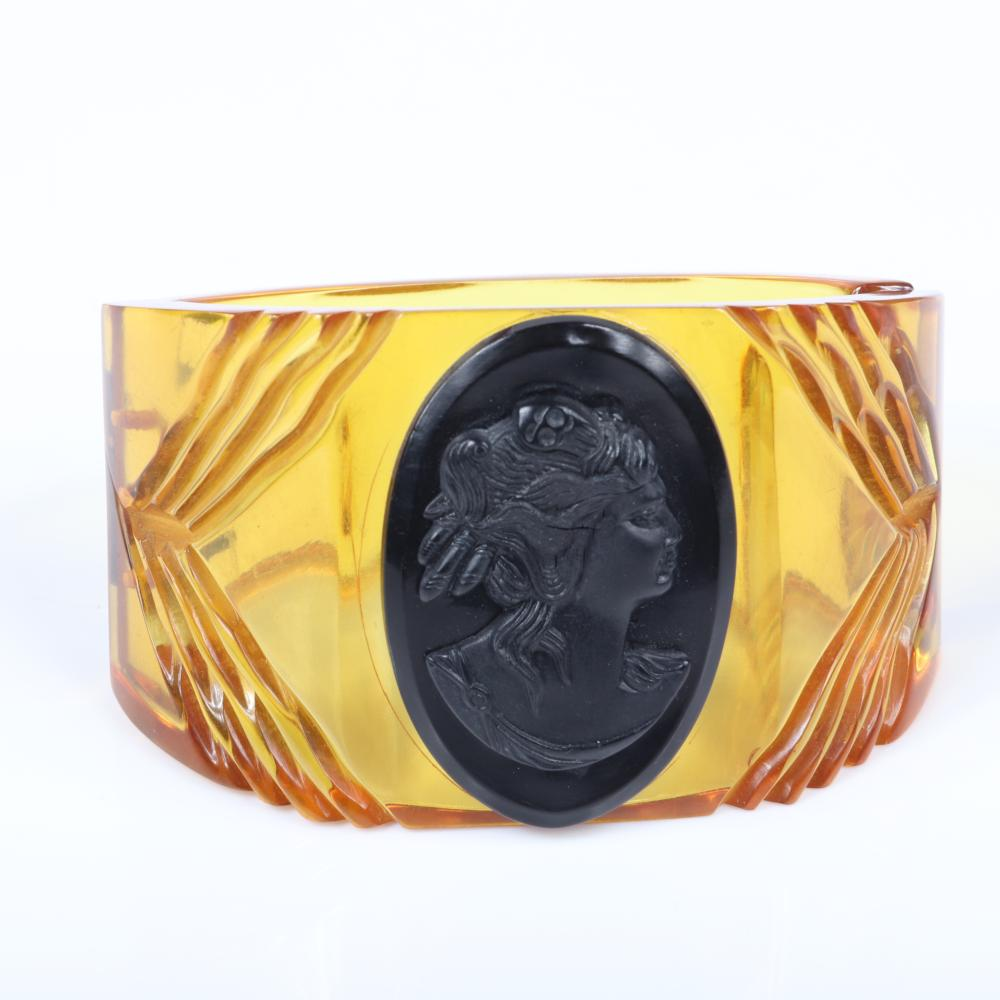 "Vintage carved Bakelite apple juice WIDE clamper cuff bracelet with black celluloid female cameo portrait. 2 1/4"" inner width, 1 3/4""W (at widest)"