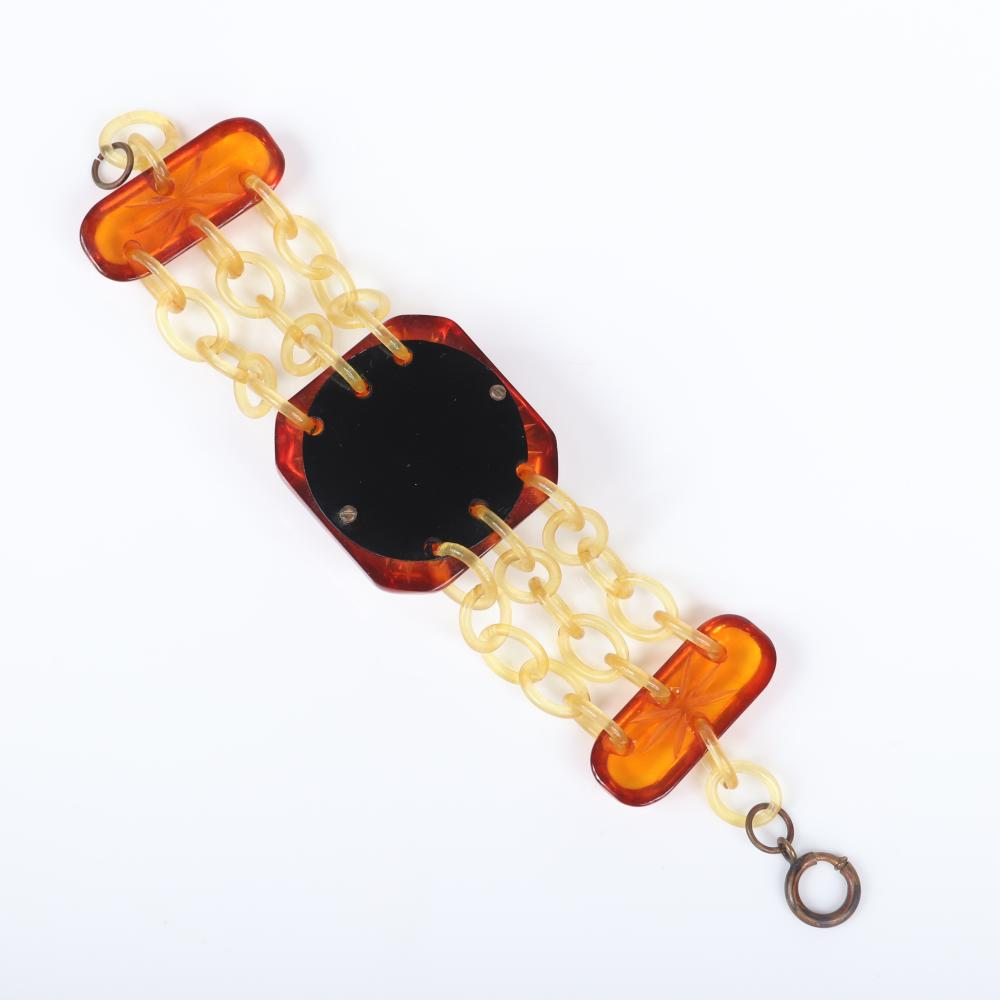"""Vintage applejuice Bakelite and three-strand celluloid chain bracelet with three reverse deep carved flower panels. 7 1/2""""L, 1 1/2""""W"""