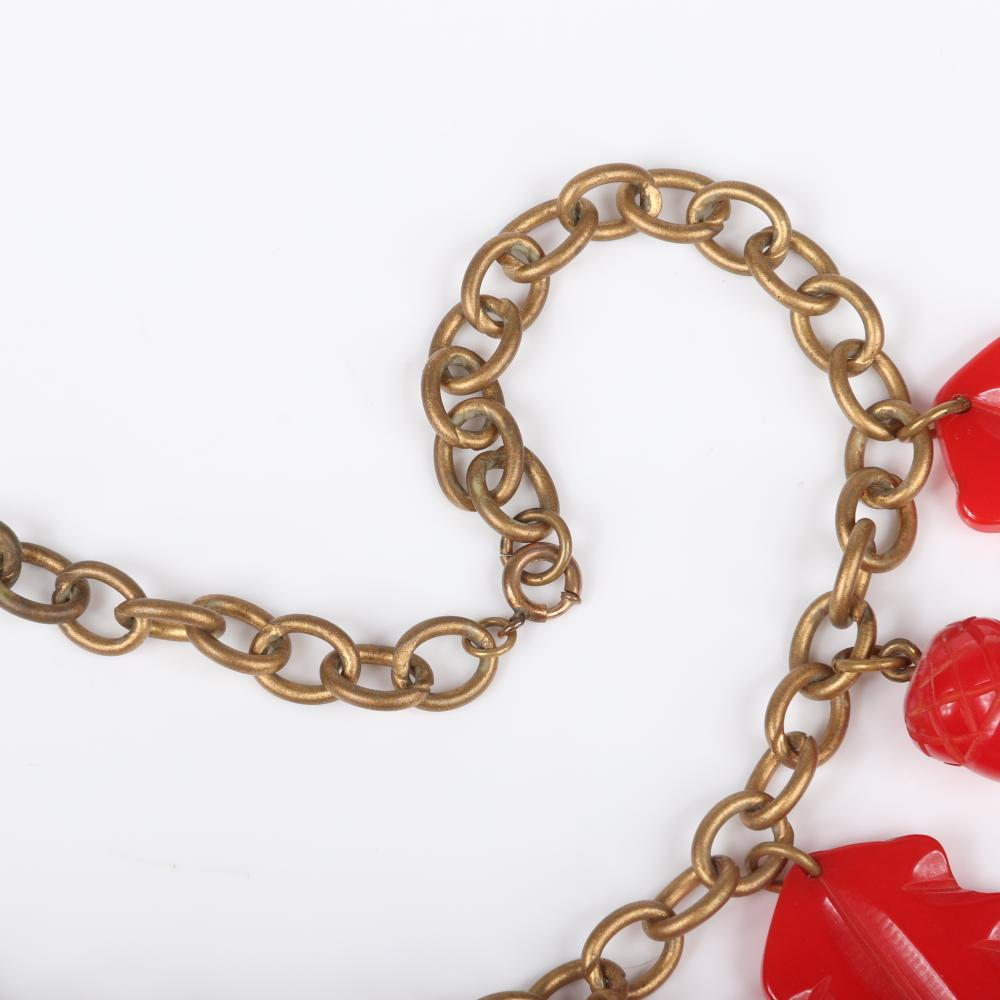 """Vintage Bakelite necklace with metal chain and red carved oak leaf and acorn dangling charms. 15""""L, 1 3/8""""H (leaf charm)"""