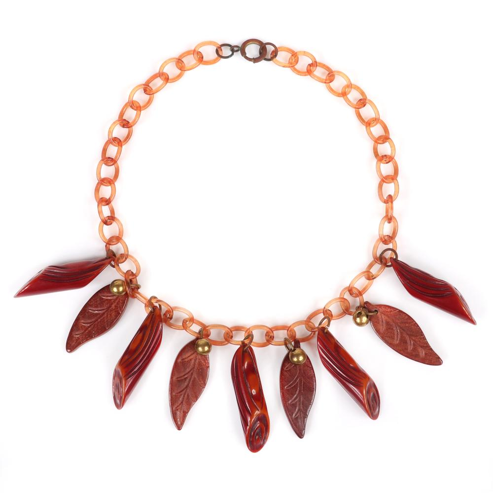 """Vintage Bakelite necklace with amber celluloid chain and carved, overdyed log charms, carved wood leaf charms and brass beads. 15""""L, 1 3/4""""H (log charm)"""