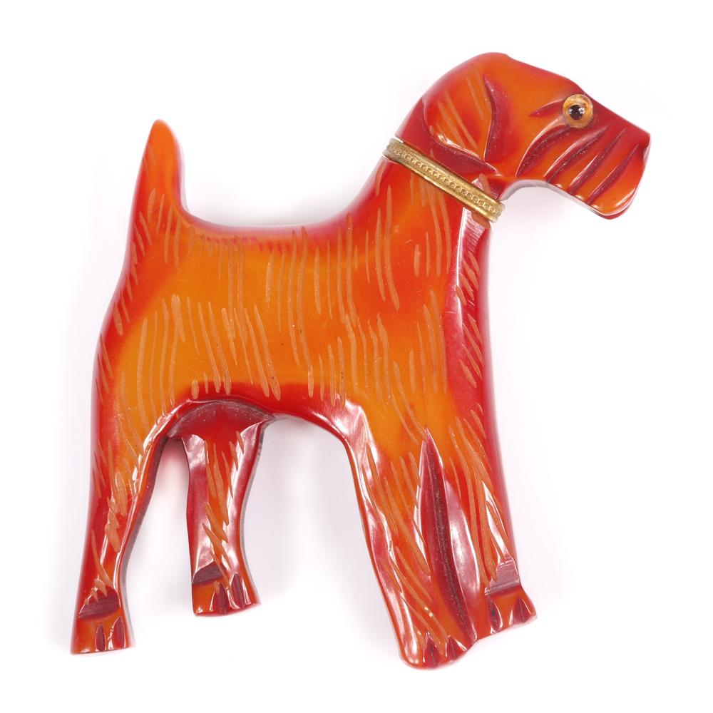 """Vintage Bakelite carved overdyed figural terrier dog pin brooch with glass eye and metal collar. 2 1/2""""H x 2 3/4""""W"""