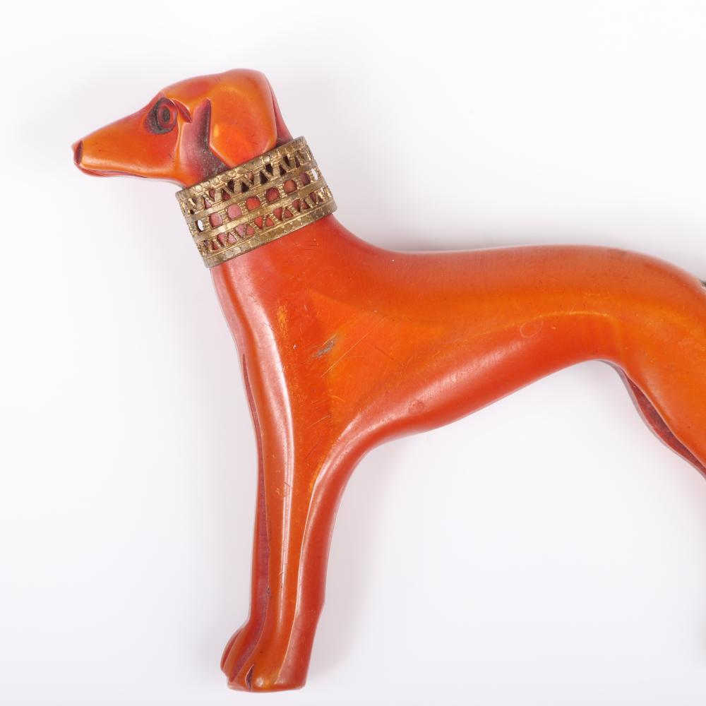 "Vintage Bakelite carved toffee greyhound figural dog pin brooch with brass lace collar, and coated string tail. 2 1/2""H x 3""W"