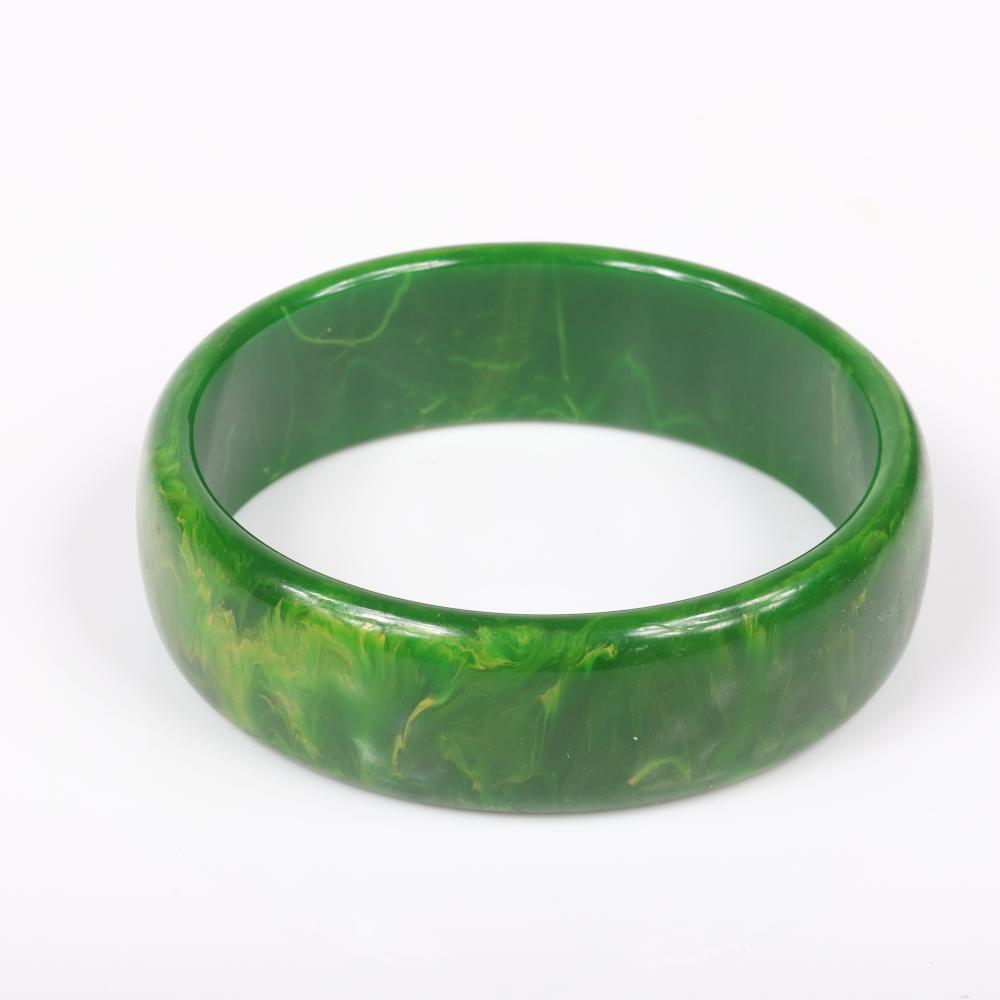 """Vintage Bakelite group: two marbled creamed spinach bangle bracelets with marbled rust domed ring. 2 1/2"""" inner diam (bangles), ring size 6"""