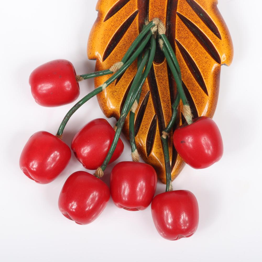 "Vintage Bakelite Dangling Fruit Cluster Pin With Seven Carved Red Apple Charms Falling From Overdyed Leaf Brooch, 1940s. 3 3/4""H x 3 1/4""W"