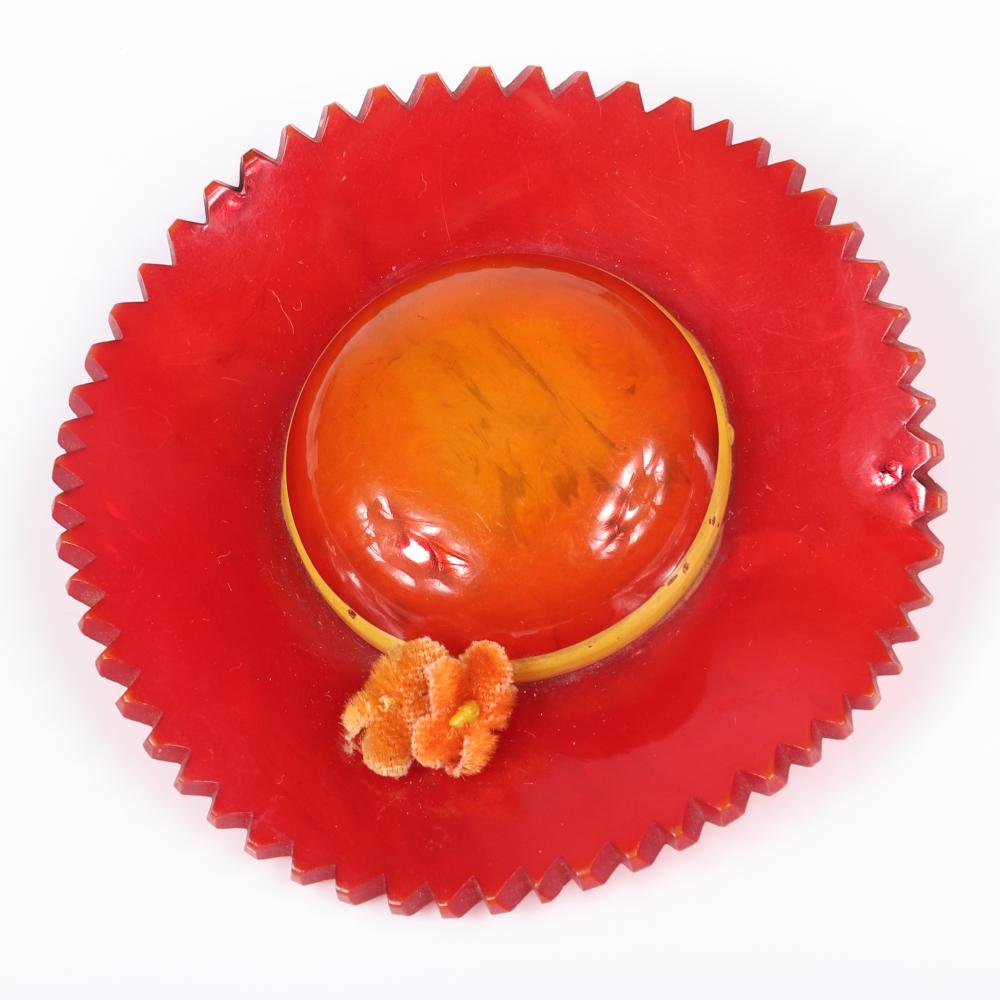 """Vintage swirled Bakelite red overdyed dimensional figural sun hat pin with scalloped edge, painted band and pink velvet flowers 3""""diam"""