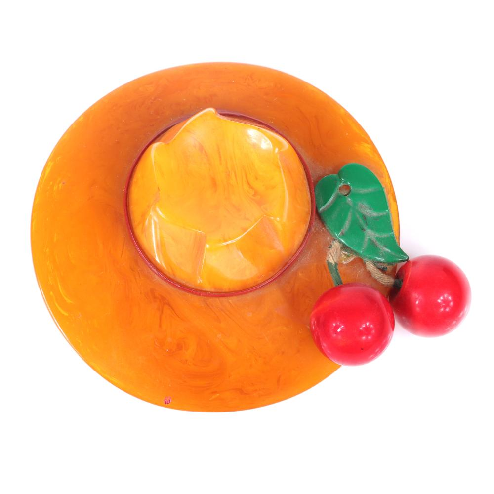 """Vintage Bakelite dimensional figural hat pin brooch in swirled butterscotch with two red dangling cherry fruit charms and leaf. 2 7/8""""diam, 1 1/4""""D"""