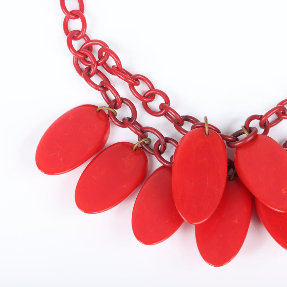 "Vintage Bakelite necklace with red celluloid double chain and nine asymmetrical tomato red sliced oval dangle charms. 16""L, 1 3/4""H (charms)"