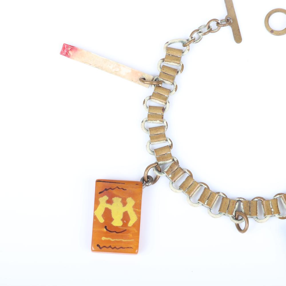 """Vintage Martha Sleeper Bakelite and celluloid cigarette boxes and matches charm bracelet with four additional Lucky Strike box charms. 7 1/4""""L, 1 1/8""""H (largest charm)"""