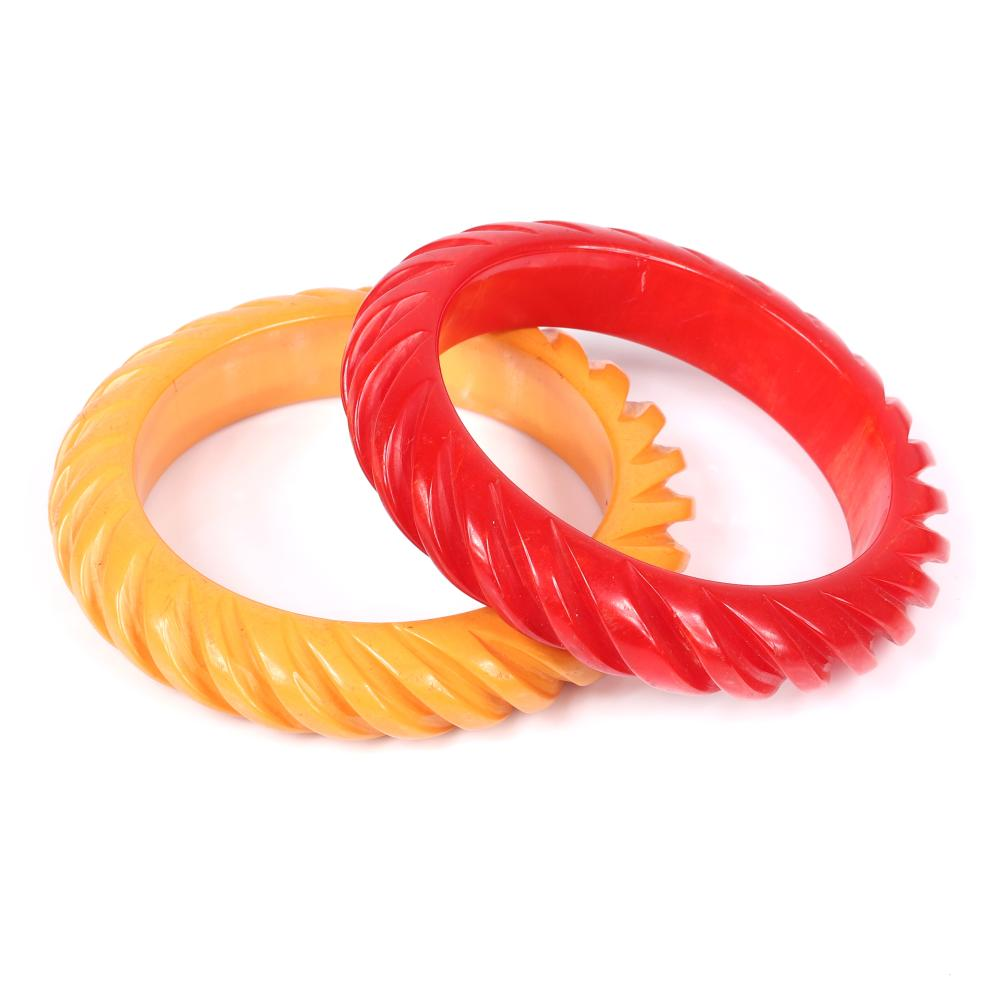 """Two vintage Bakelite deeply carved matching bangle bracelets in red and butterscotch / custard yellow. 2 1/2""""inner diam, 1/2""""W"""