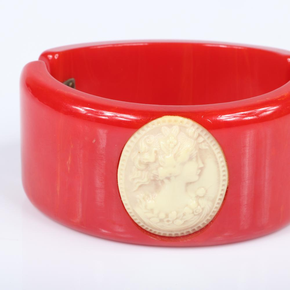 "Vintage Bakelite WIDE CHERRY RED clamper cuff bracelet with celluloid cameo applique. 2 3/8""inner width, 1 3/8""W"