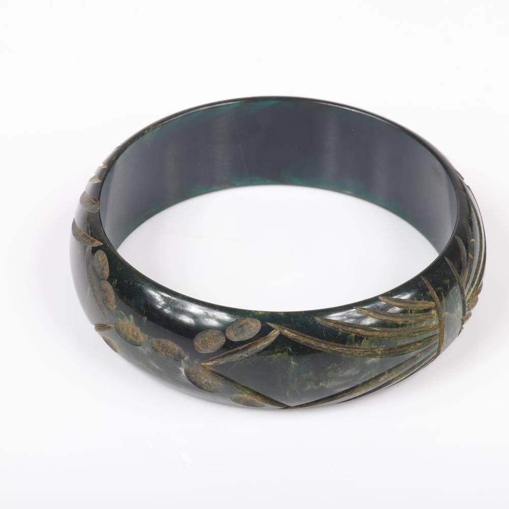 """Vintage Bakelite group: two carved with matching pattern bangle bracelets in red and swirled creamed spinach with button earrings. 2 1/4"""" inner diam, 3/4""""W (green)"""