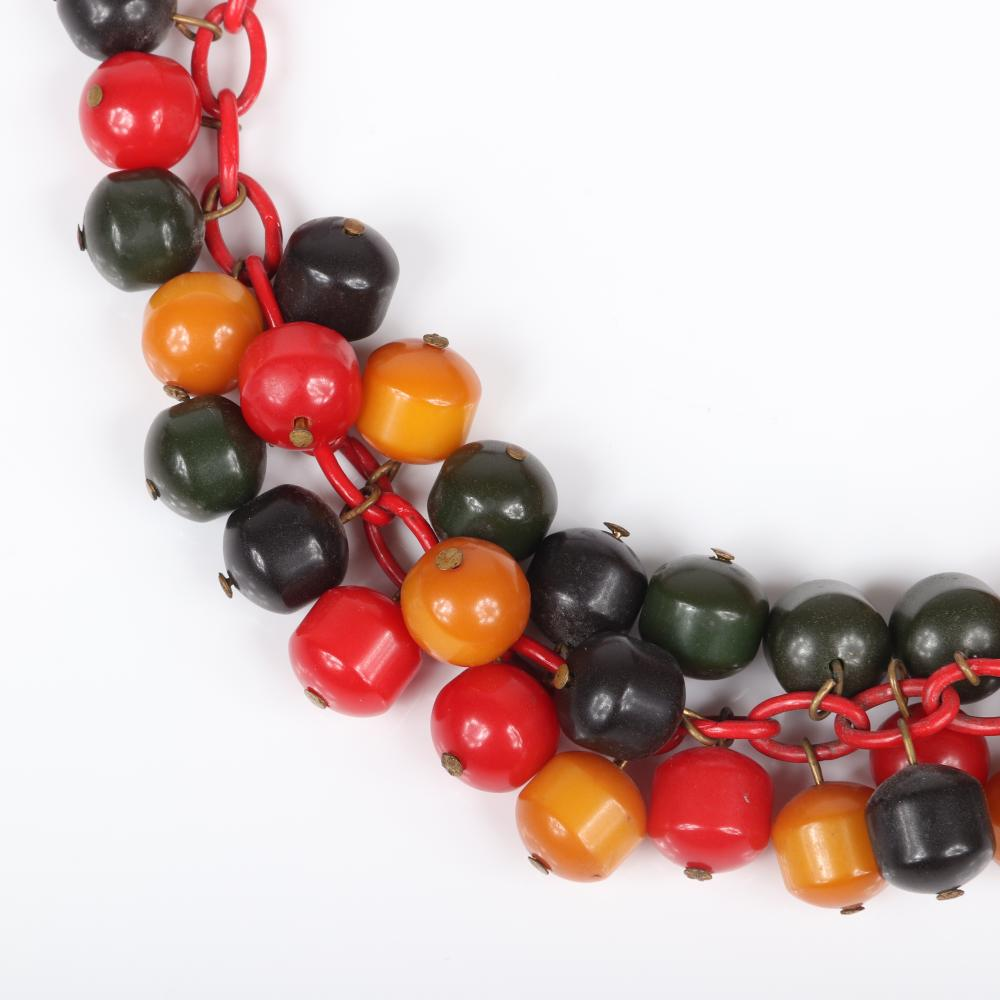"""Vintage Bakelite tri-color bauble choker necklace on red celluloid chain with beads in black, butterscotch, green, and red. 15""""L"""