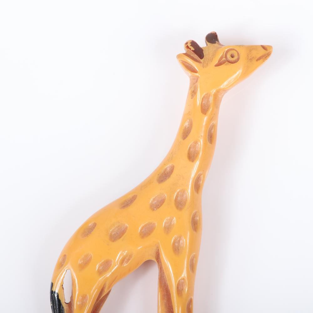 """Vintage Bakelite carved cream / butterscotch large giraffe figural animal pin brooch with painted features. 4""""H x 1 1/2""""W"""