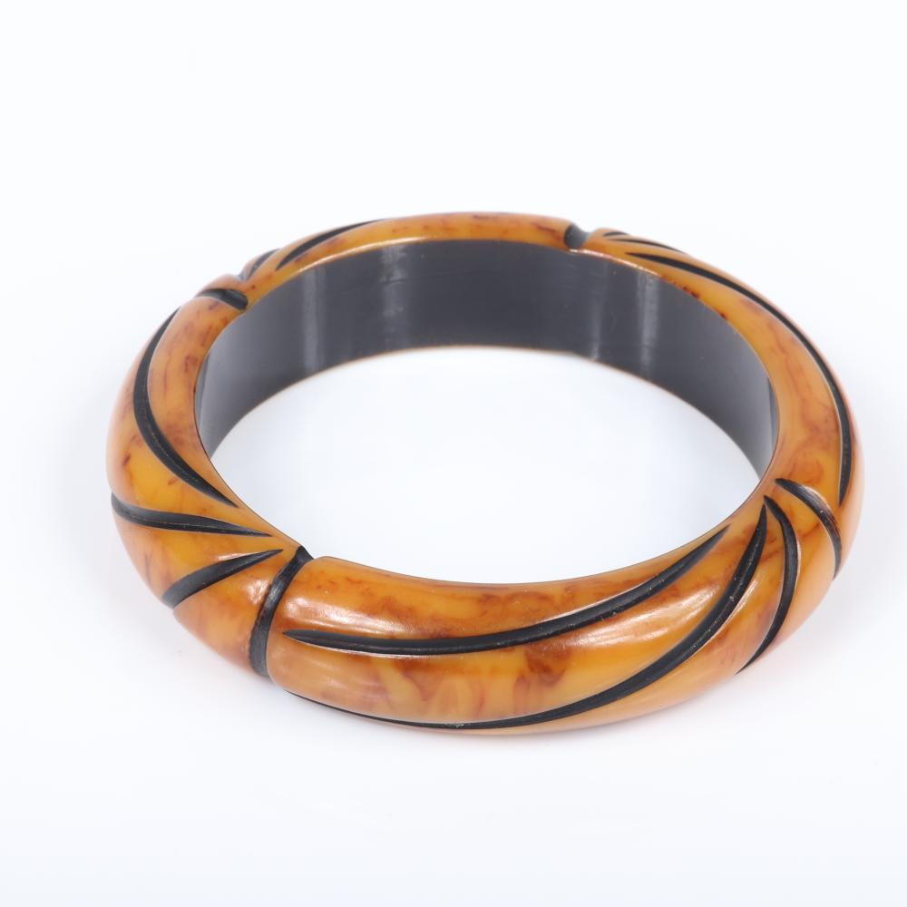 """Bakelite vintage group: two carved marbled egg yolk yellow bangle bracelets, one overdyed, with pair carved and marbled green hoop earrings. 2 1/2"""" x 5/8"""" inner diam, 5/8""""W (bracelets)"""