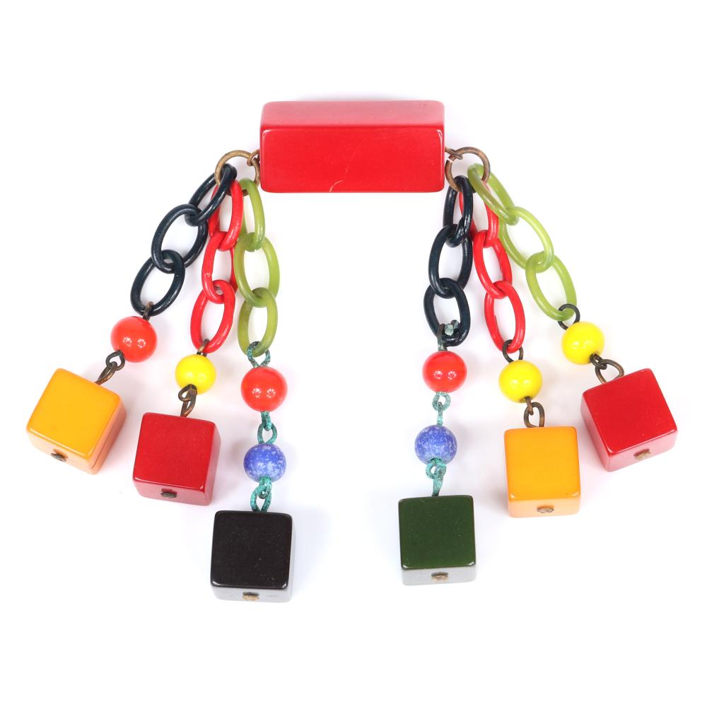 "Vintage Martha Sleeper? Bakelite tri-color cube dangle pin with multi color Czech glass beads and celluloid chains suspended from red bar pin. 3 1/2""H x 3""W"
