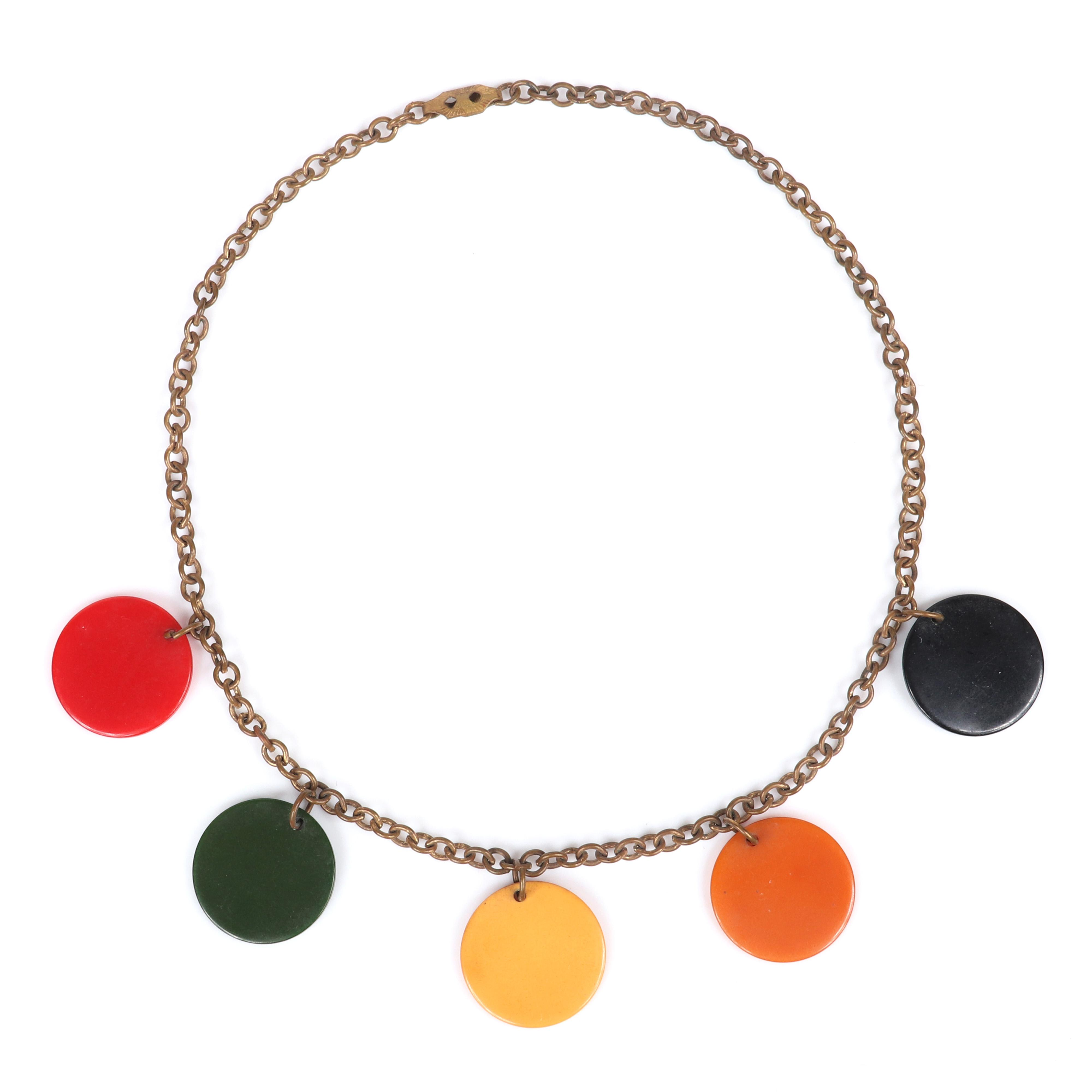 """Vintage Bakelite choker necklace with brass chain and 5 multi color disk charms in black, orange, cream, green, and tomato red. 14""""L, 7/8""""diam (each disk)"""
