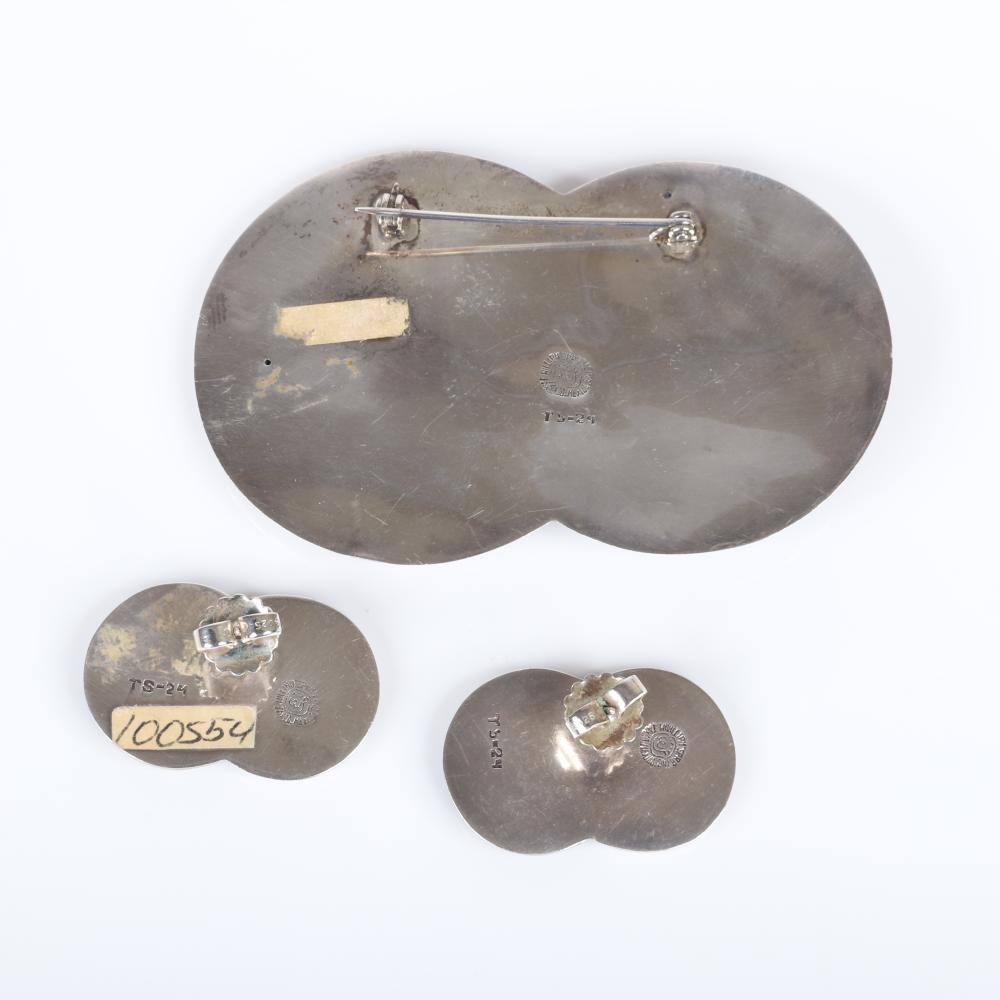 """William Spratling Taxco Mexico modernist sterling silver and copper Celestial Sun and Moon pin brooch and earring set with mixed metal design. 2""""H x 3 1/4""""W (brooch), 1 1/4""""H x 3/4""""W (earrings)"""