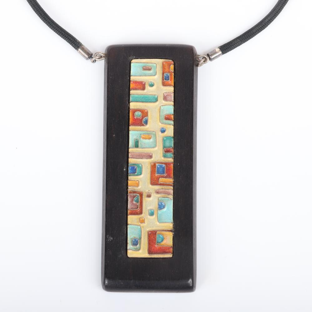 """Mildred Ball American Modernist large wood pendant with inlaid blue and rust enamel geometric square panel on woven black cord. 13""""L (necklace), 3 3/4""""H x 1 1/4""""W (pendant)"""