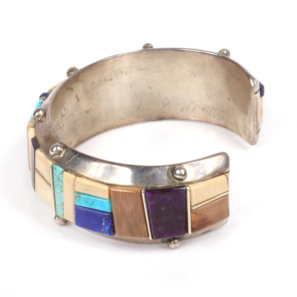 """Native American Hopi/Yaqui Indian Michael & Cassandra Duckepoo sterling silver cuff bracelet with geometric wedge inlay of turquoise, fossilized bone, lapis & sugilite. 2 1/4"""" (inner width), 3/4""""W"""