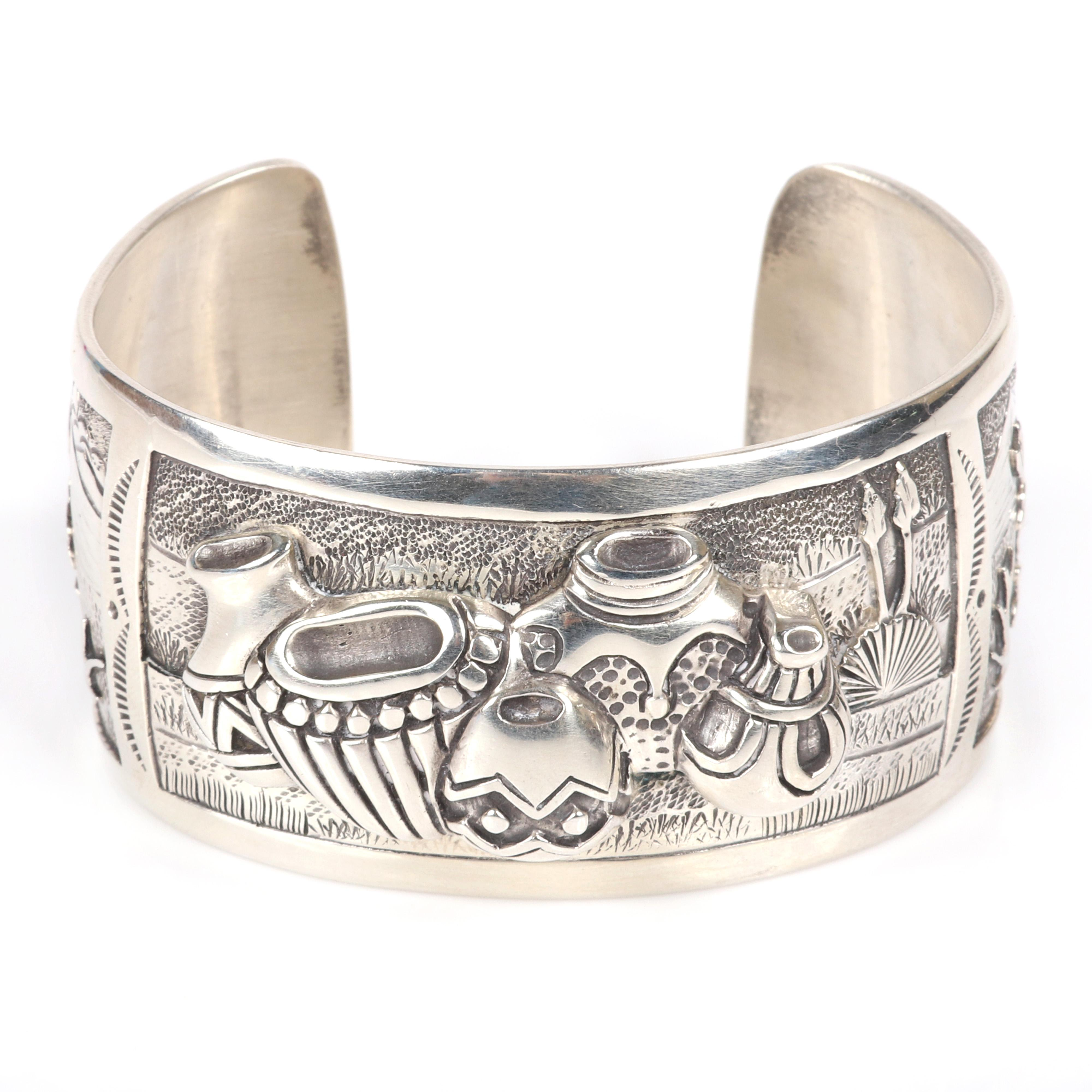 """Ray Calladitto Native American Indian Navajo sterling silver cuff bracelet with three scenic panels featuring pottery jars cast in high relief, and flanking eagle scenes. 2 1/4""""diam, 1 1/4""""W"""