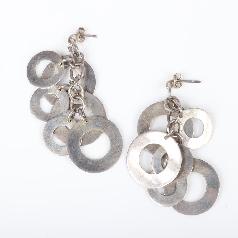 """Sterling silver artisan jewelry group: openwork linked disk necklace and earrings with six dangling circles suspended on a chain. 18""""L (necklace), 1 1/2""""H (openwork disks), 2 3/4""""H (earrings)"""
