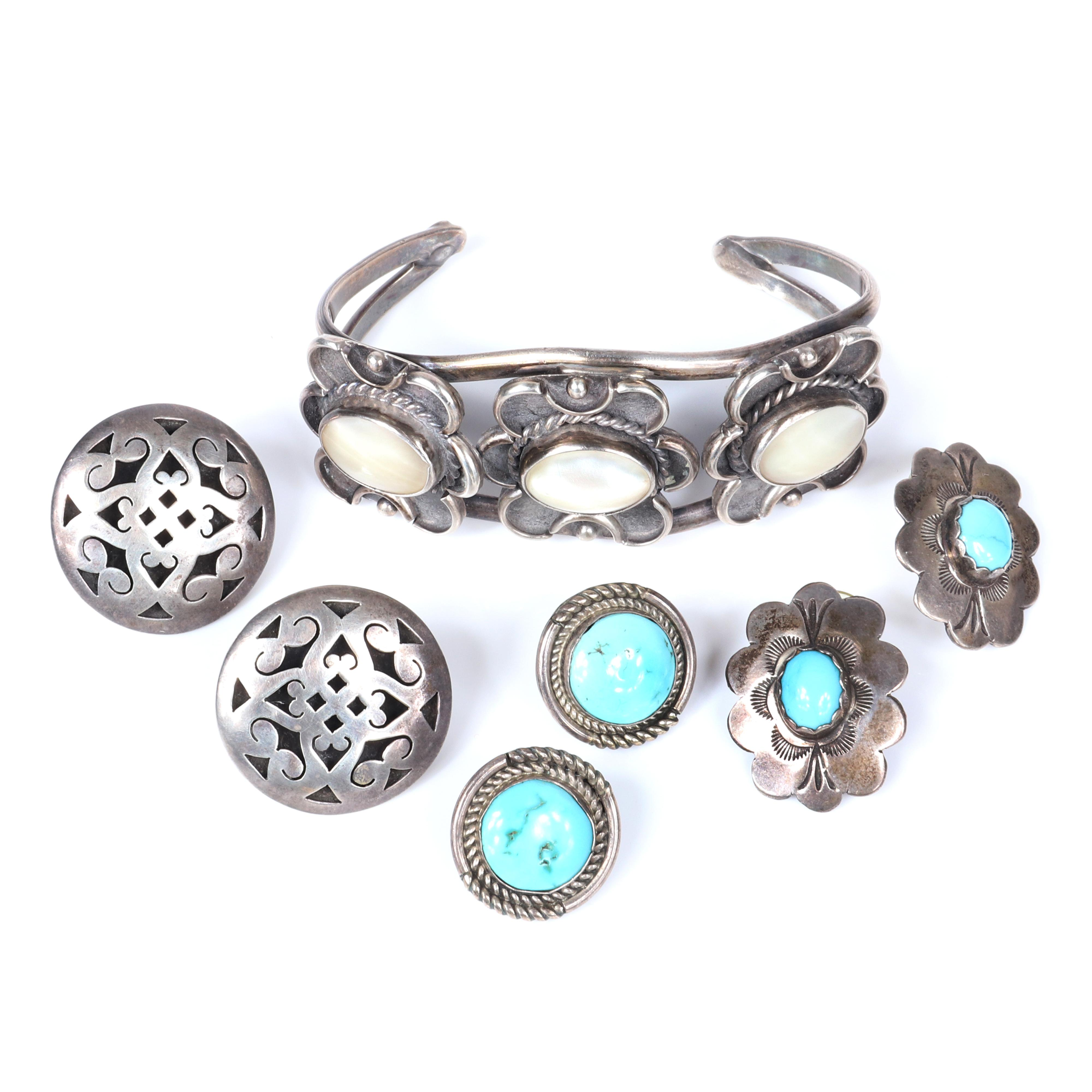 """Sterling silver and stone 4pc group: cuff bracelet with white shell cabochons, concho earrings with turquoise, Mexican silver openwork earrings, turquoise button earrings. 2 3/4"""" inner width (bracelet), 51.2g (all)"""