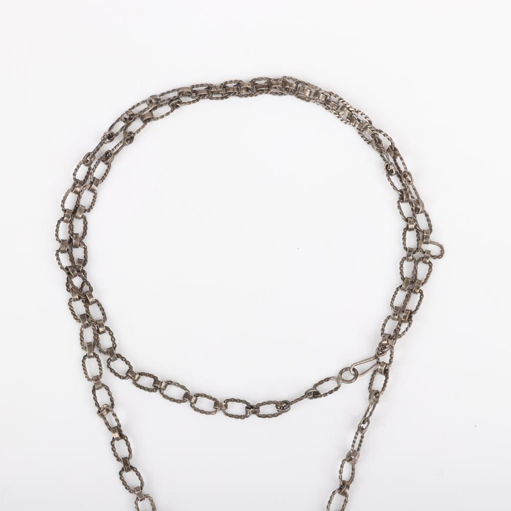"""Modernist silver textured linked chain necklace and pendant with two spinning openwork abstract bands, probably Israeli artist designer. 26""""L (necklace), 2""""H (pendant)"""