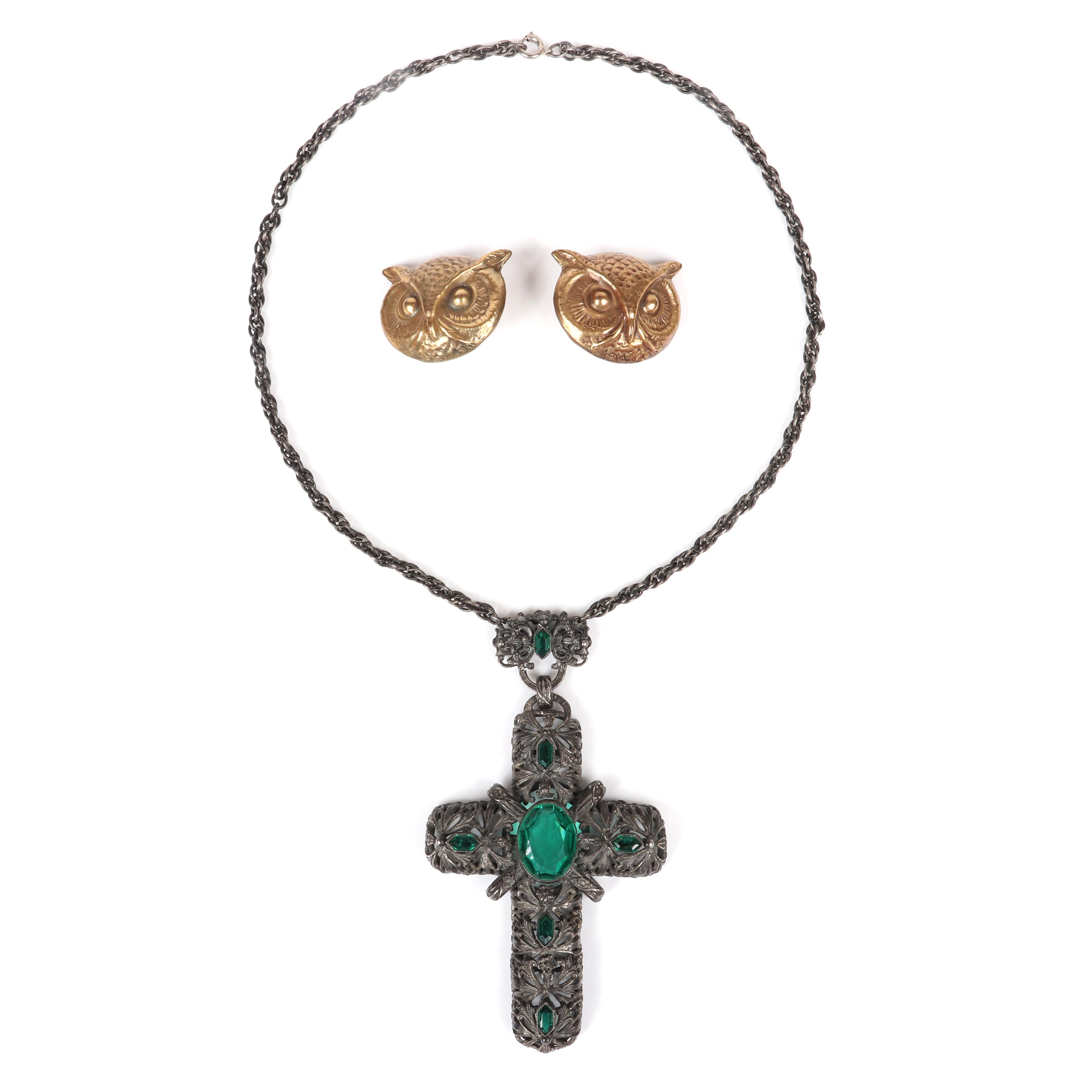 "Joseff of Hollywood large gold tone brass repousse owl head earrings and antiqued silver tone necklace with large openwork cross pendant and faceted emerald crystals. 1 1/4""H x 1 1/2""W (owls), 18""L (necklace), 4 1/2""H..."