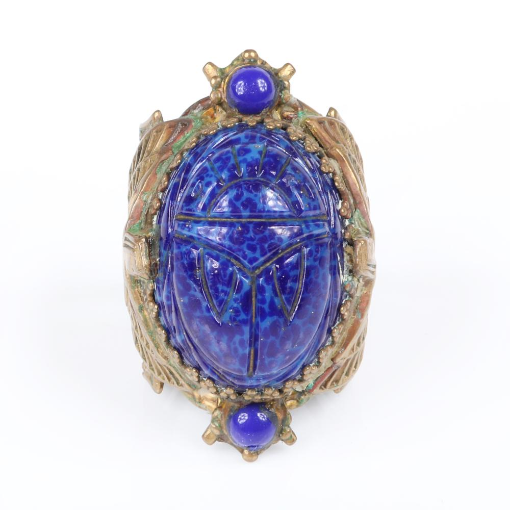 Egyptian Revival 1920s Art Deco ring with LARGE carved blue lapis Peking glass scarab cabochon and winged Pharaoh figures on the band. size 5 3/4