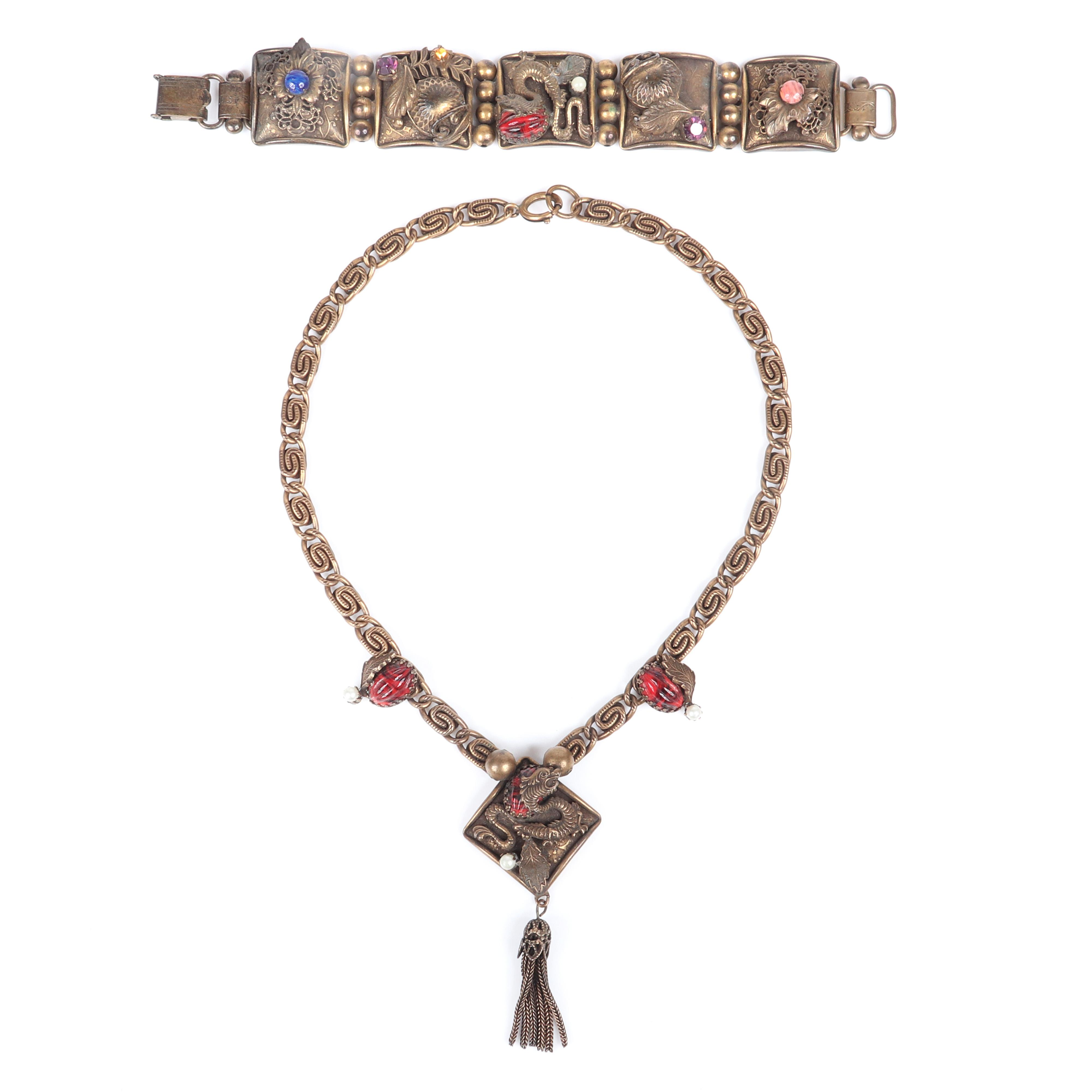 "Czech Art Deco Egyptian Revival panel link repousse bracelet and necklace and fringed pendant set with snake design, faux pearls, rhinestones and peking melon shaped glass. 17""L"