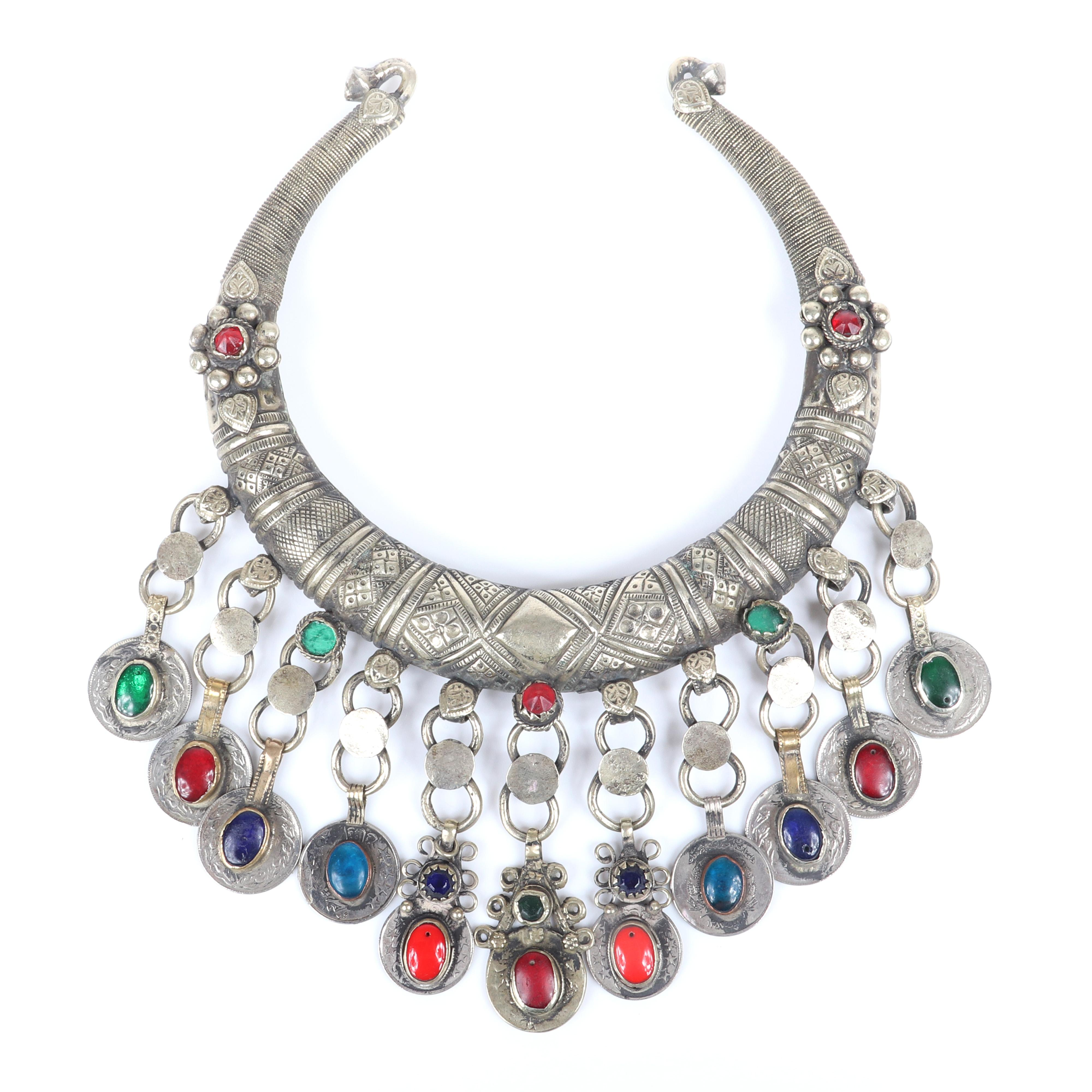 """Vintage old silver chunky Middle Eastern tribal torc collar necklace with dangling links with Rupee coins and glass jewel cabochons in red, blue and green with stamped motif. 7 1/4"""" diam., 3 1/2"""" drop"""