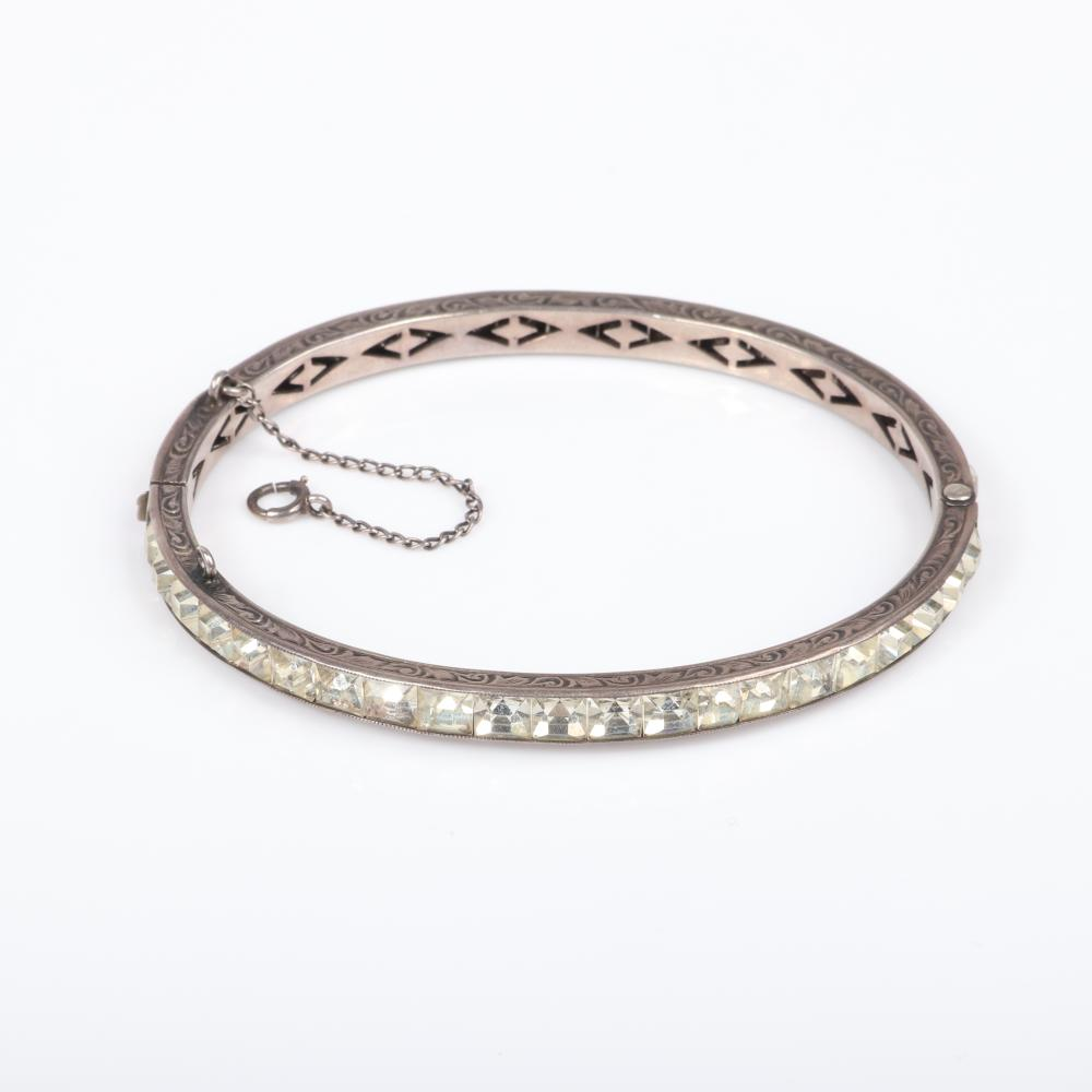 """Edwardian sterling silver group: spiral rhinestone earrings, large dotted textured belt buckle and French paste diamante bangle bracelet with channel set rhinestones. 2 1/4""""H x 4""""W (buckle)"""