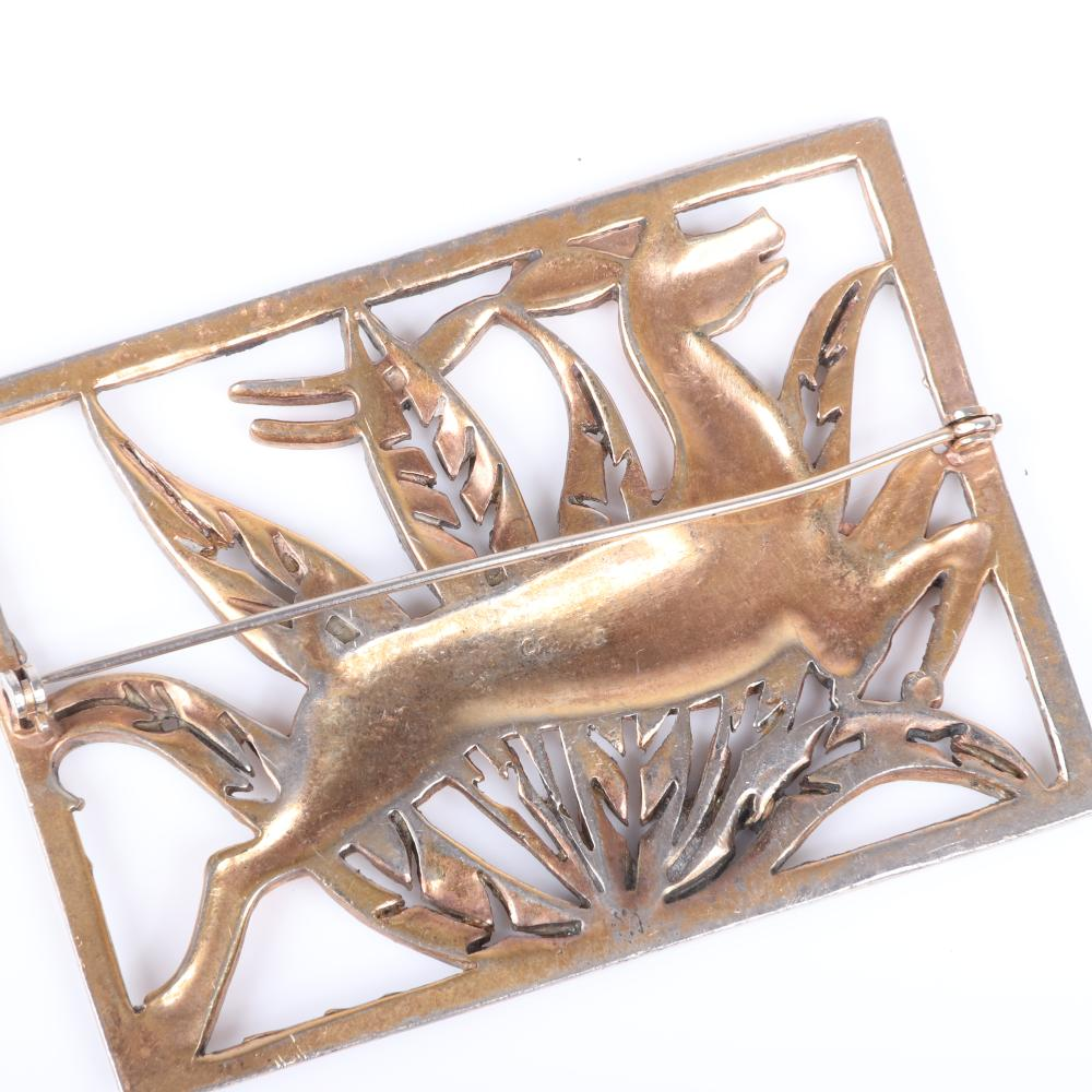 "Chanel Novelty Art Deco openwork brooch with gold tone antelope stag over silver foliage and frame. 2""H x 2 3/4""W"